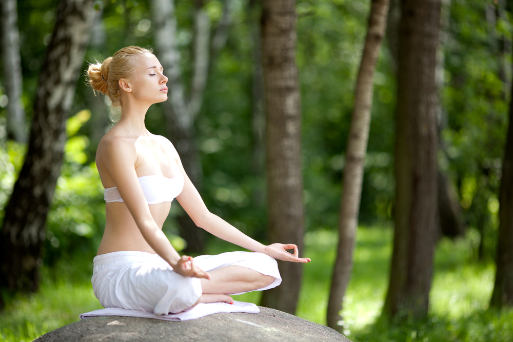 Since the 1970s, meditation and other stress-reduction techniques have been studied as possible treatments for depression and anxiety. One such practice, yoga, has received less attention in the medical literature, though it has become increasingly popular in recent decades. One national survey estimated, for example, that about 7.5% of U.S. adults had tried yoga at least once, and that nearly 4% practiced yoga in the previous year. Yoga classes can vary from gentle and accommodating to strenuous and challenging; the choice of style tends to be based on physical ability and personal preference. Hatha yoga, the most common type of yoga practiced in the United States, combines three elements: physical poses, called asanas; controlled breathing practiced in conjunction with asanas; and a short period of deep relaxation or meditation. Available reviews of a wide range of yoga practices suggest they can reduce the impact of exaggerated stress responses and may be helpful for both anxiety and depression. In this respect, yoga functions like other self-soothing techniques, such as meditation, relaxation, exercise, or even socializing with friends. By reducing perceived stress and anxiety, yoga appears to modulate stress response systems. This, in turn, decreases physiological arousal — for example, reducing the heart rate, lowering blood pressure, and easing respiration. There is also evidence that yoga practices help increase heart rate variability, an indicator of the body's ability to respond to stress more flexibly. A small but intriguing study done at the University of Utah provided some insight into the effect of yoga on the stress response by looking at the participants' responses to pain. The researchers noted that people who have a poorly regulated response to stress are also more sensitive to pain. Their subjects were 12 experienced yoga practitioners, 14 people with fibromyalgia (a condition many researchers consider a stress-related illness that is characterized by hypersensitivity to pain), and 16 healthy volunteers. When the three groups were subjected to more or less painful thumbnail pressure, the participants with fibromyalgia — as expected — perceived pain at lower pressure levels compared with the other subjects. Functional MRIs showed they also had the greatest activity in areas of the brain associated with the pain response. In contrast, the yoga practitioners had the highest pain tolerance and lowest pain-related brain activity during the MRI. The study underscores the value of techniques, such as yoga, that can help a person regulate their stress and, therefore, pain responses. Although many forms of yoga practice are safe, some are strenuous and may not be appropriate for everyone. In particular, elderly patients or those with mobility problems may want to check first with a clinician before choosing yoga as a treatment option. But for many patients dealing with depression, anxiety, or stress, yoga may be a very appealing way to better manage symptoms. Indeed, the scientific study of yoga demonstrates that mental and physical health are not just closely allied, but are essentially equivalent. The evidence is growing that yoga practice is a relatively low-risk, high-yield approach to improving overall health. Disclaimer: